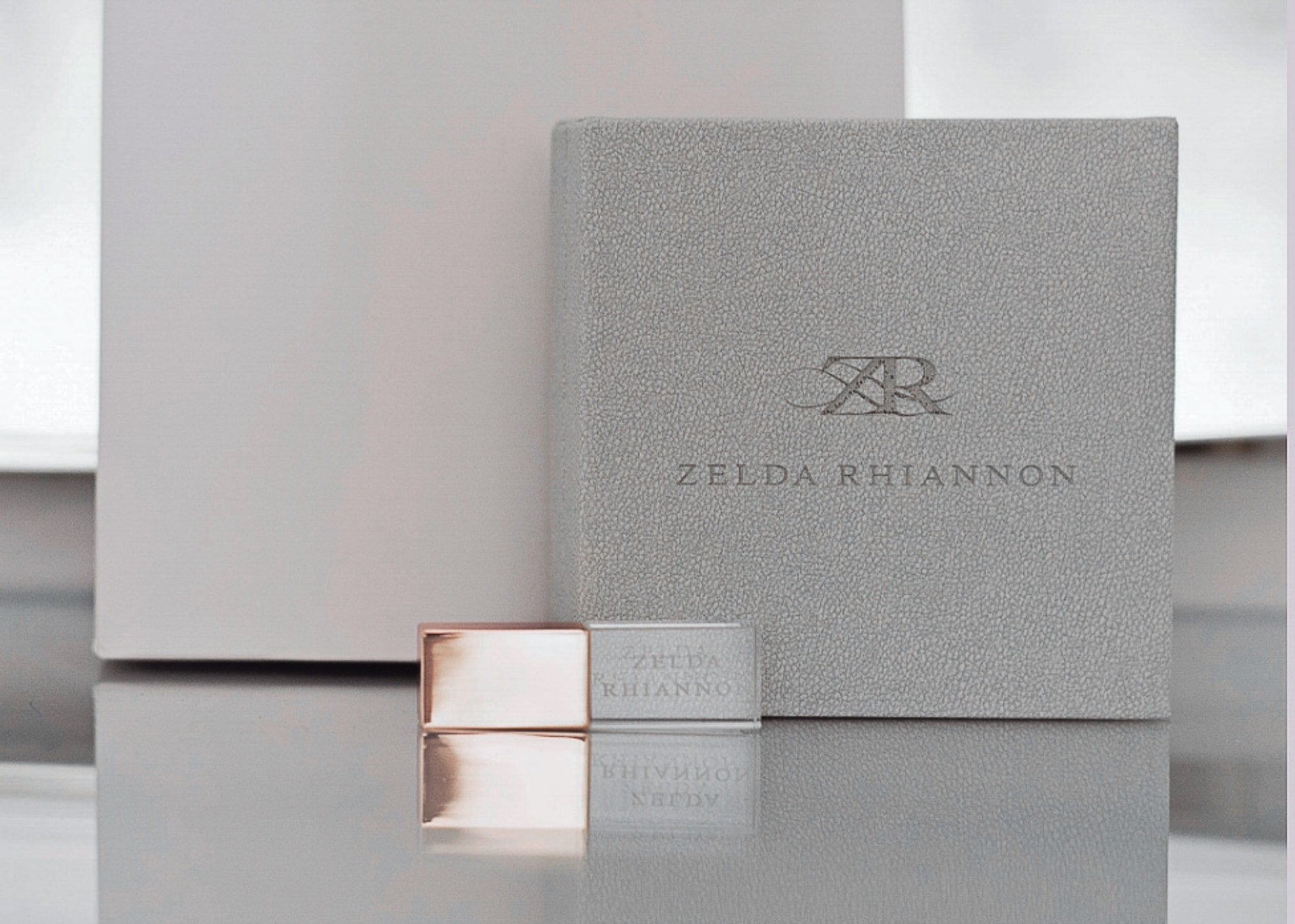 a usb with a rose gold lid and a grey box